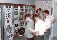 PQ-6 Control console. Standing in the foreground is Ron Burgess with Geoge Allan in front of him ope